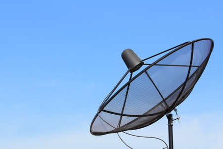 Black satellite dish with blue sky  photo