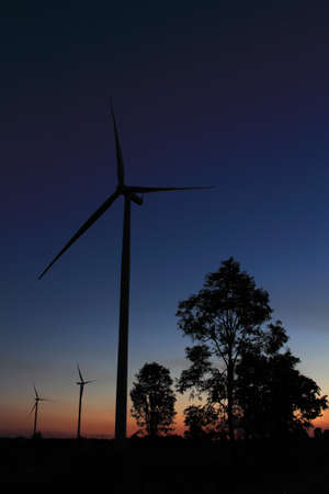 Wind turbines at sunset in Thailand  Stock Photo