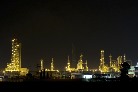Petrochemical plant at night in Thailand  Stock Photo