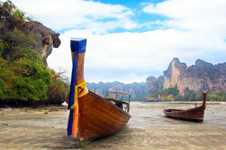 Tropical beach and long tail boat at Andaman Sea in Krabi, Thailand  photo
