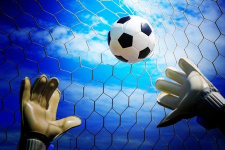 Soccer ball in goal with loss goalmam photo