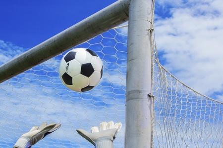 oal: Soccer ball in goal with loss goalmam