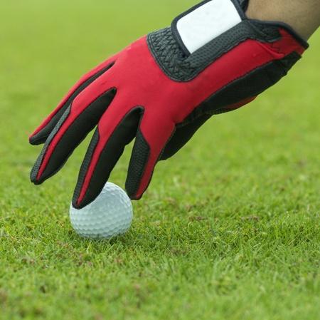 Close-up hand hold golf ball photo