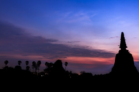 pious: Silhouette of buddha in Ayutthaya, Thailand Stock Photo
