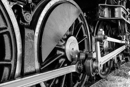 Black and white of Grunge antique steam train wheel photo