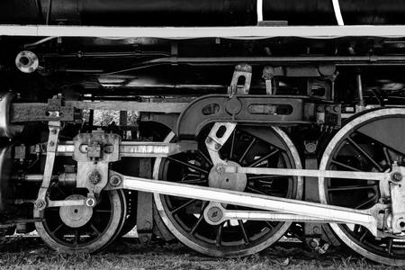 Black and white of Grunge antique steam train wheel photo