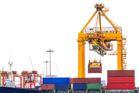 Container Cargo freight ship with working crane bridge in shipyard on white background photo