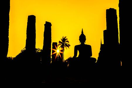 Silhouette Buddha Statue at Wat Mahathat in Sukhothai Historical Park,Thailand photo