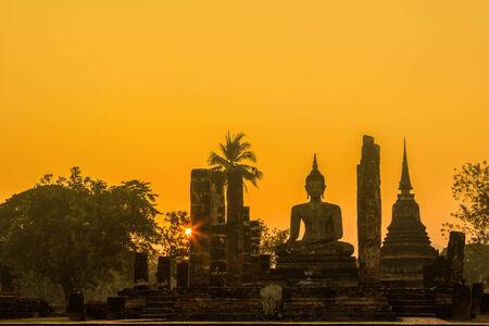 Buddha Statue at Wat Mahathat in Sukhothai Historical Park,Thailand  photo