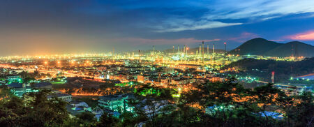 Petrochemical plant at panorama view in twilight sky  Imagens