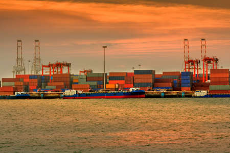 Industrial Container Cargo freight ship with working at sunset