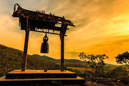 Ancient bell at sunset in Phrabuddhachay Temple Saraburi, Thailand.