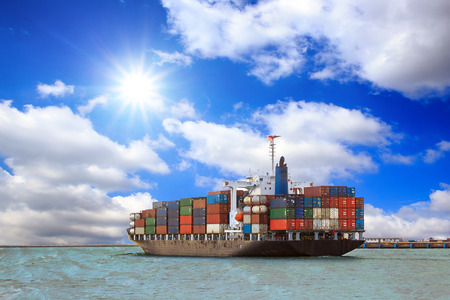 ship bow: Cargo container ship at mediterranean coast with Blue sky Stock Photo