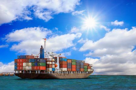 Cargo container ship at mediterranean coast with Blue sky Archivio Fotografico