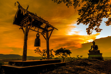Buddha statue at sunset in Saraburi, Thailand