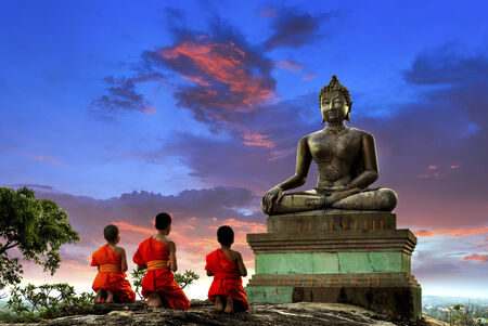 Buddha statue and Novice at sunset in Saraburi, Thailand