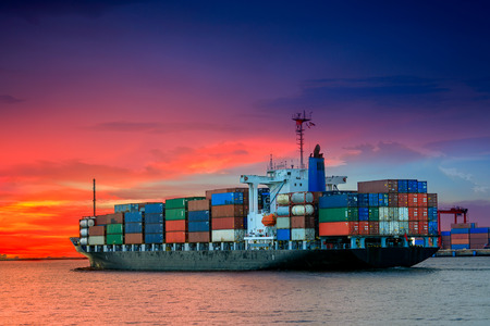 cargo container ship at mediterranean coast in sunset Imagens - 28986298