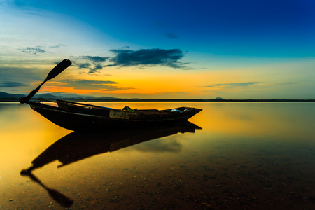 Old fishing boat at sunset  Imagens