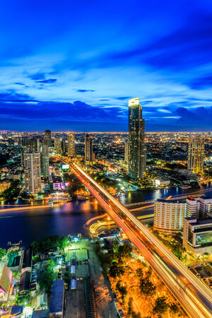 Modern building at riverside in twilight scene[Bangkok, Thailand] Imagens - 28986347