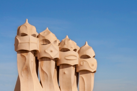 Chimneys on the roof of Casa Mila against a clear sky in Barcelona Stock Photo