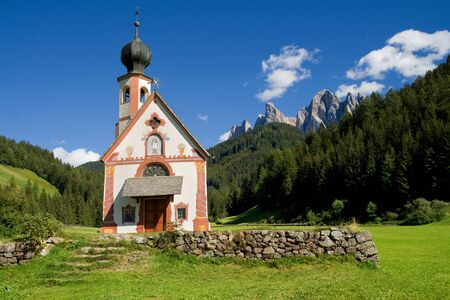 odle: Church of St  Johann in Ranui in the valley of Villnoss with the Odle mountains in the background, Dolomites, Italy