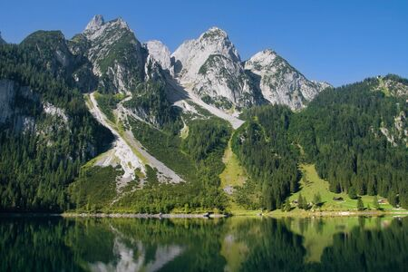 bordering: Mountains bordering the Gosausee lake in the Salzkammergut region, Austria. Stock Photo