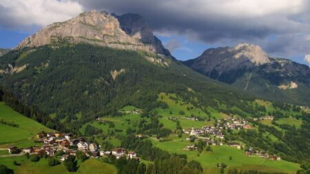 selva: Mountainous landscape with the villages of Colle Santa Lucia and Selva di Cadore, at the Dolomites  Stock Photo