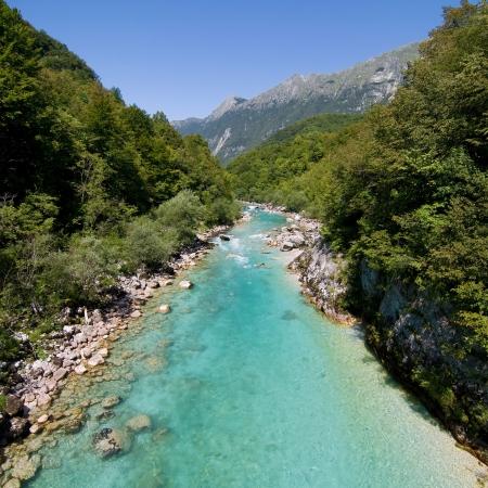 The emerald green waters of the alpine river Soca in Slovenia. photo