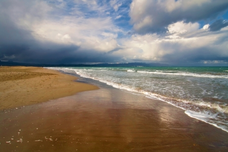 Storm clouds approaching a deserted beach  Stock Photo