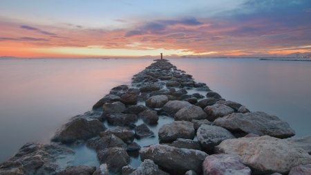 Breakwater rocks on the Gulf of Roses, Spain, at long exposure