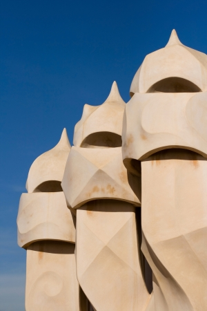 Chimneys covered with ceramic fragments that look like helmets at La Pedrera  Casa Mila  in Barcelona, Spain  Casa Mila was built in 1906-1910 by the famous catalan architect Antoni Gaudi