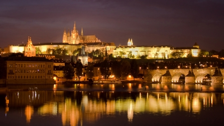 Castle and Charles Bridge by night in Prague, Czech Republic  photo
