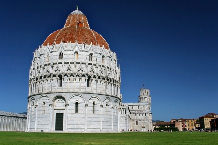 Piazza dei Miracoli of Pisa with the Baptistery of Saint John  Battistero di San Giovanni  in the foreground, Tuscany, Italy  photo
