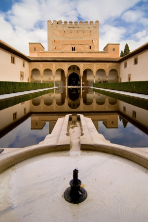 turrets: Comares tower reflected in the pond of the Court of the Myrtles in La Alhambra, Granada, Spain
