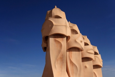Chimneys covered with ceramic fragments that look like helmets at La Pedrera Casa Mila at Barcelona, Catalonia