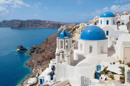 Village of Oia on Santorini island with Therasia island in the background, Greece