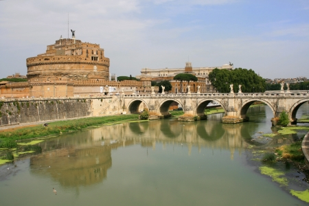 Rome, Italy - August 24, 2007: Castel Sant Angelo (Mausoleum of Hadrian) and Sant Angelo bridge over the Tiber river, Rome, Italy.