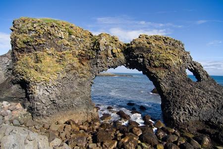 rock arch: Volcanic rock arch Gaktlettur near Arnarstapi in Snaefellsness peninsula, Iceland