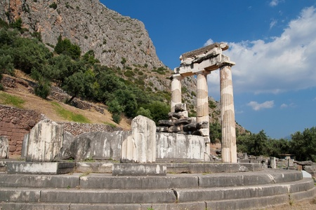 Three standing doric columns in the Sanctuary of Athena Pronaia in Delphi, Greece  photo