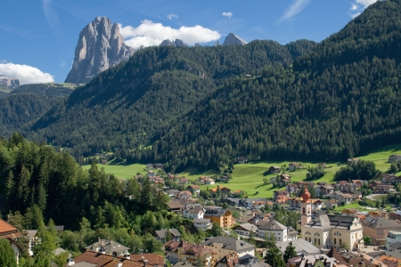 Overview of Ortisei  Sankt Ulrich  with the Sassolungo  Langkofel  in the background, Italy  photo