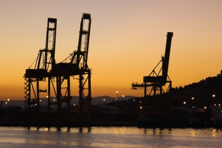 Cargo cranes on the harbour of Barcelona at sunset, Catalonia  photo