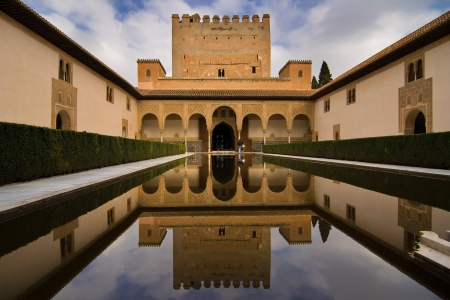 Patio de los Arrayanes  Court of the Myrtles  in La Alhambra, Granada, Spain  The Torre de Comares  Comares tower  is reflected in the pond