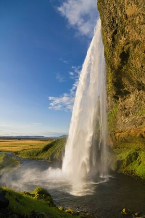 Seljalandsfoss waterfall at dusk, South Iceland  photo