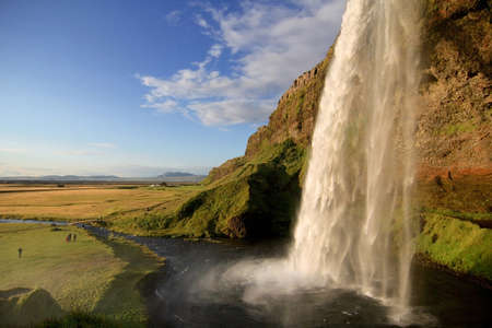 Seljalandsfoss waterfall at dusk, near Eyjafjallajokull glacier in South Iceland  photo