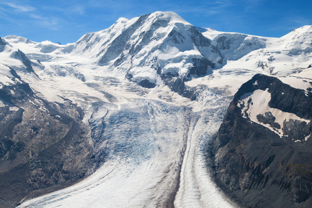 Lyskamm summit and Grenz glacier in the Swiss Alps  photo