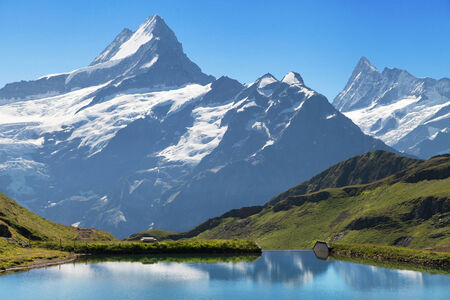 Peaks of the Schreckhorn and Finsteraarhorn from the Bachalpsee lake in the Swiss Alps  photo