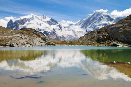 monte: Monte Rosa and Lyskamm reflected on the Riffelsee in the Swiss Alps