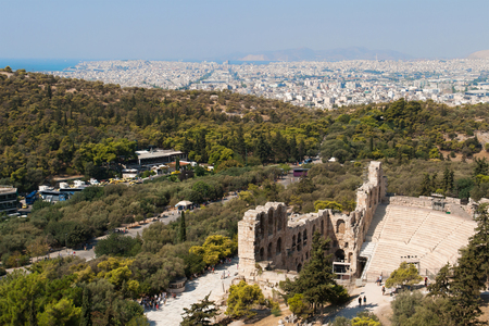 Odeon of Herodes Atticus in Athens with the city of Piraeus in the background  photo