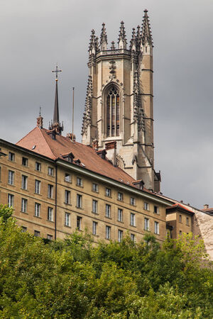 'saint nicholas': Bell Tower of the Cathedral of Saint Nicholas in Fribourg, Switzerland  Stock Photo