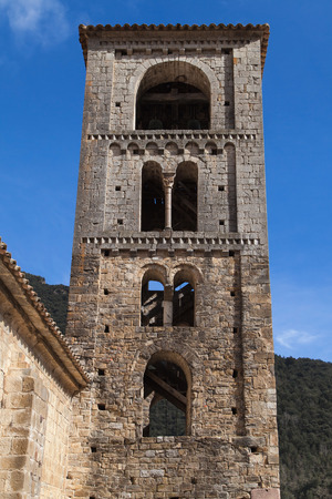 romanesque: Romanesque bell tower of Sant Cristofol church in Beget, Girona province, Catalonia. Stock Photo